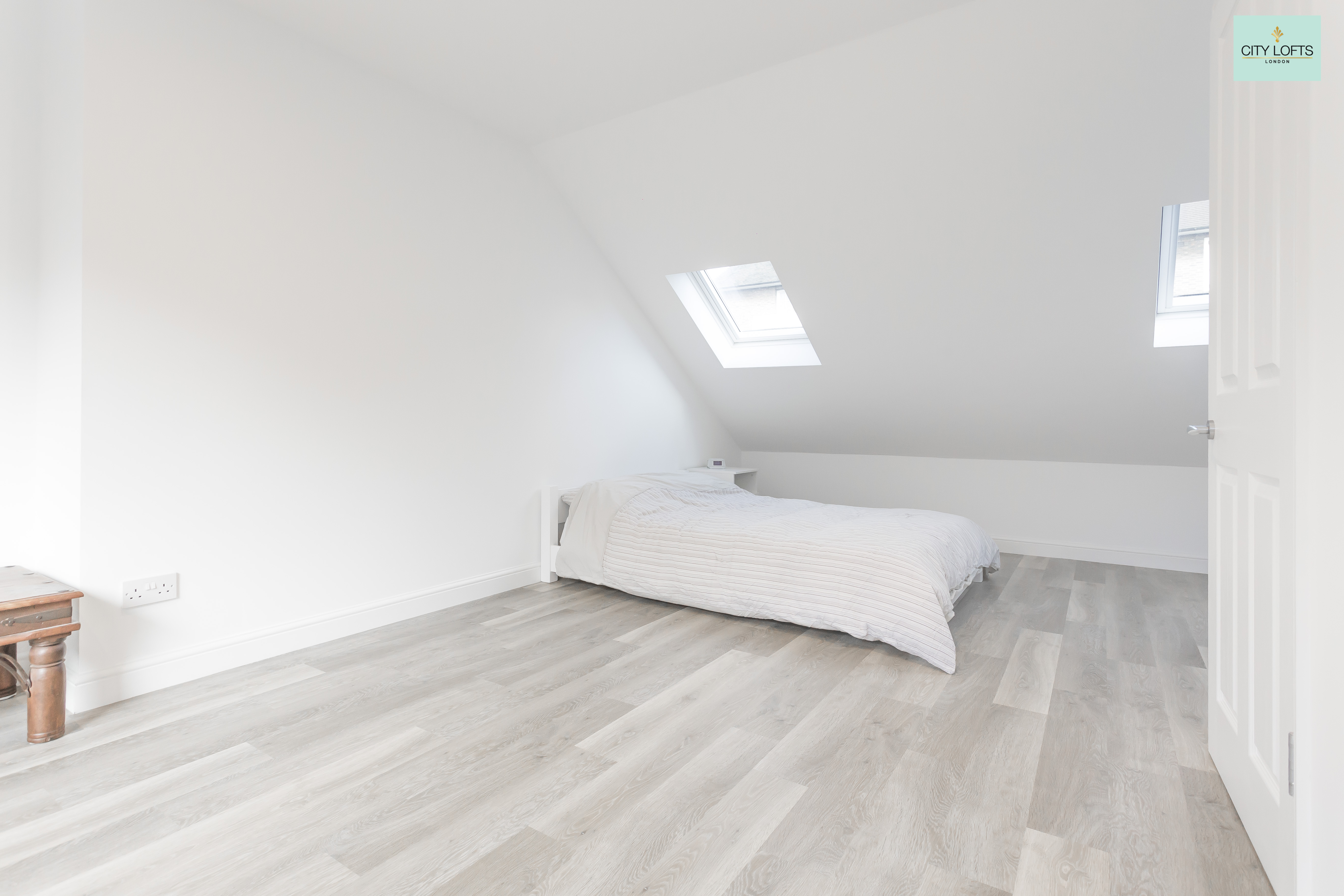 Holloway Loft Conversion Grey Flooring Bedroom