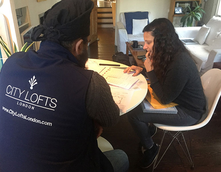 Image of City Lofts team talking with one of our clients
